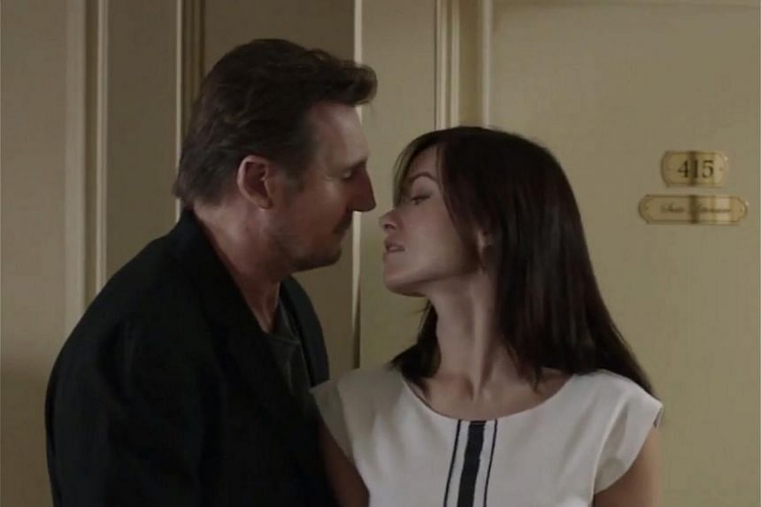 Liam Neeson, playing an obsessed writer in Paris, has an affair with a hot younger woman (Olivia Wilde, both above) behind the back of his tired-looking, hurt wife (Maria Bello). -- PHOTO: YOUTUBE