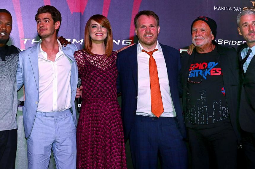 Attending the promotional event of The Amazing Spider-Man 2 in Singapore were (from left) cast members Jamie Foxx, Andrew Garfield and Emma Stone, director Marc Webb and producers Avi Arad and Matt Tolmach. -- PHOTO: THE NEW PAPER FILE
