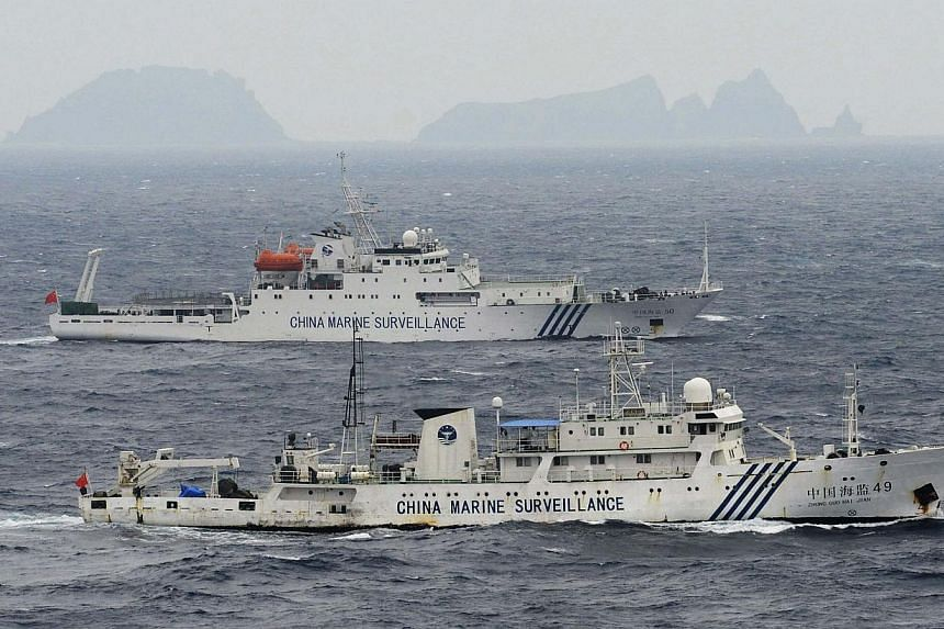 "An aerial photo shows Chinese marine surveillance ships Haijian No. 49 (front) and Haijian No. 50 cruising in the East China Sea. Reclaiming its ""historic waters"" in the East and South China Seas is becoming central to the Chinese Communist Party"