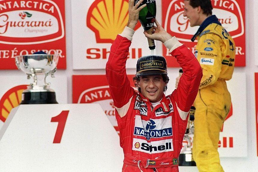 Ayrton Senna celebrating his victory in the Brazilian Grand Prix, Sao Paulo, in March 1993. -- FILE PHOTO: AFP