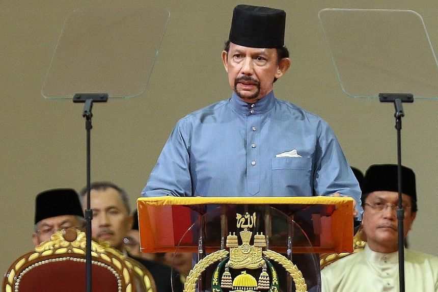 Brunei's Sultan Hassanal Bolkiah delivers a speech during the official ceremony of the implementation of syariah law in Bandar Seri Begawan on April 30, 2014. The Sultan of Brunei announced on April 30 that a controversial new penal code featuring to
