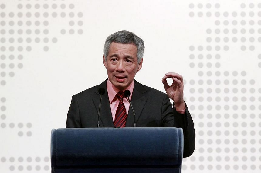 Prime Minister Lee Hsien Loong urged Singaporeans to honour the pioneer generation of unionists by building upon their achievements, in his May Day message on Wednesday, on April 30, 2014. -- FILE PHOTO:ZAOBAO
