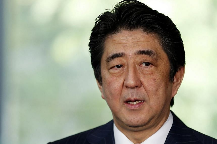 Japanese Prime Minister Shinzo Abe kicked off his one-week tour of Europe on Wednesday, April 30, 2014, by telling a German business audience that he was confident his country would soon win its battle against years of deflation. -- FILE PHOTO: REUTE