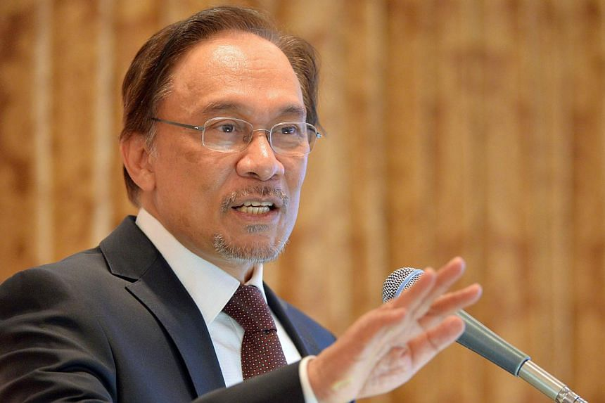 The Malaysian police said on Wednesday, April 30, 2014, they would allow a May Day rally against price rises that will include opposition leader Anwar Ibrahim (pictured), retracting earlier statements that the protest would be illegal. -- FILE PHOTO: