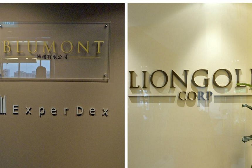 The respective Central Plaza offices of Blumont Group (left) andLionGold Corp, two of theeight listed companies being probed over the penny stock rout that wiped out billions of dollars in market value last October.-- ST FILE PHOTO: