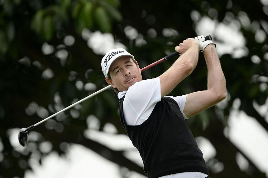 Defending champion Brett Rumford of Australia hitting a shot during the Pro Am competition of the China Open at the Genzon Golf Club in the southern Chinese city of Shenzhen, on April 23, 2014. The European Tour has picked up any costs its members in