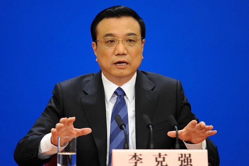 China will step up support for the trade sector, including quickening the pace of tax rebate payment for exporters, Premier Li Keqiang said on Wednesday, April 30, 2014, as part of policy measures to support a slowing economy. -- FILE PHOTO: AFP