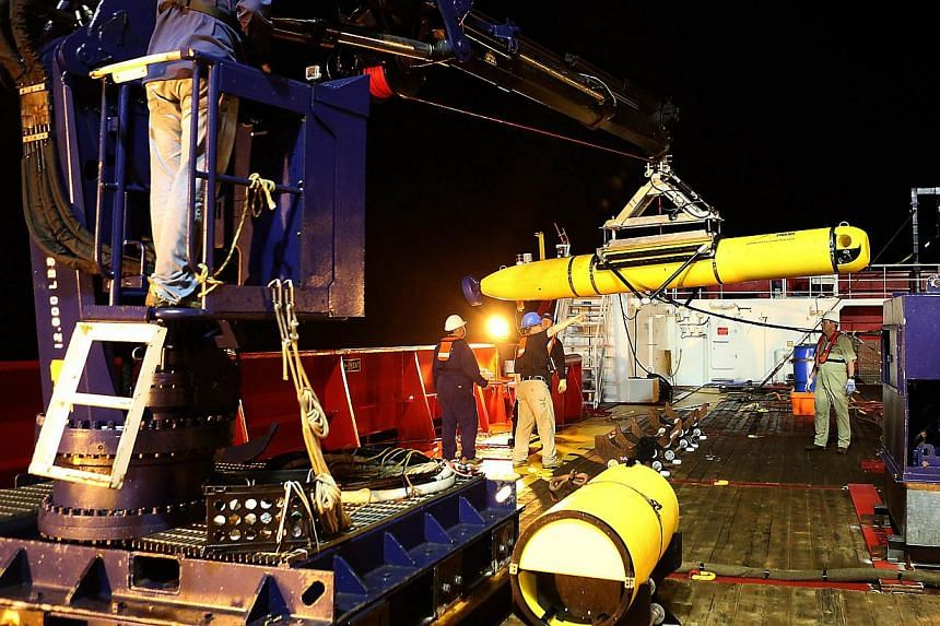 The Phoenix Autonomous Underwater Vehicle (AUV) Artemis being recovered onto Australian Defence Vessel Ocean Shield after completing a mission in the search for the missing Malaysia Airlines Flight MH370 in the southern Indian Ocean, on April 17, 201