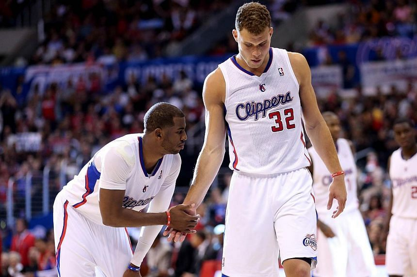 Chris Paul (left) and Blake Griffin of the Los Angeles Clippers shake hands as they come out of a time out against the Golden State Warriors in Game Five of the Western Conference quarter-finals during the 2014 NBA Play-offs at Staples Centre, on Apr