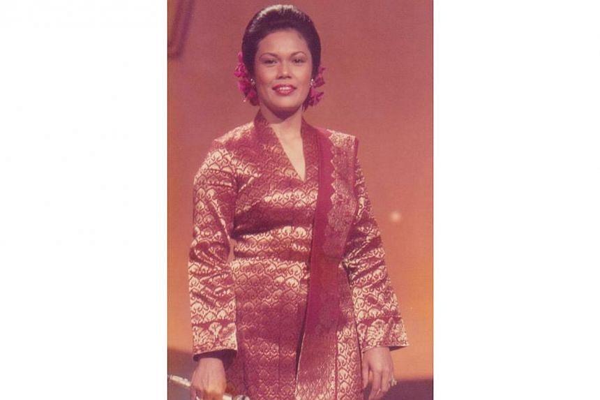 During her younger days, veteran singer Kartina Dahari's signature look was a traditional kebaya made of songket material, with her hair pinned into an elaborate chignon. -- FILE PHOTO: KARTINA DAHARI