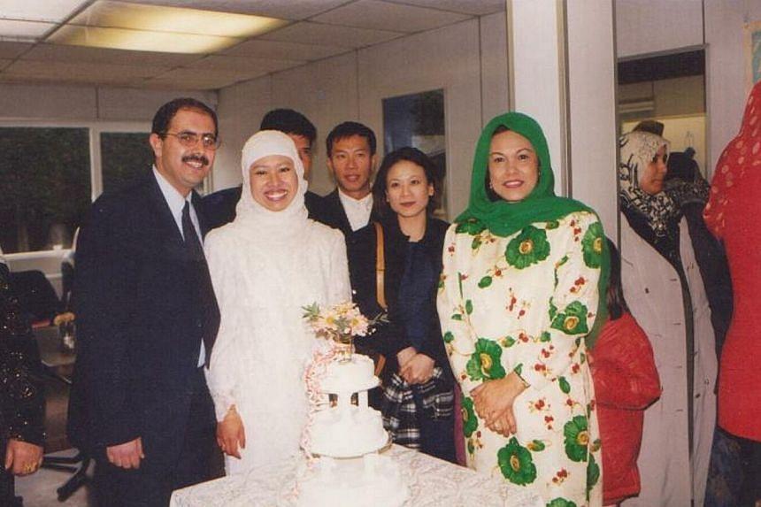 Veteran singer Kartina Dahari (in green headscarf) in London, attending the wedding of her eldest daughter, Adlin Adnan (in white) to Palestinian journalist and lecturer Ibrahim Darwish (left). -- FILE PHOTO: KARTINA DAHARI