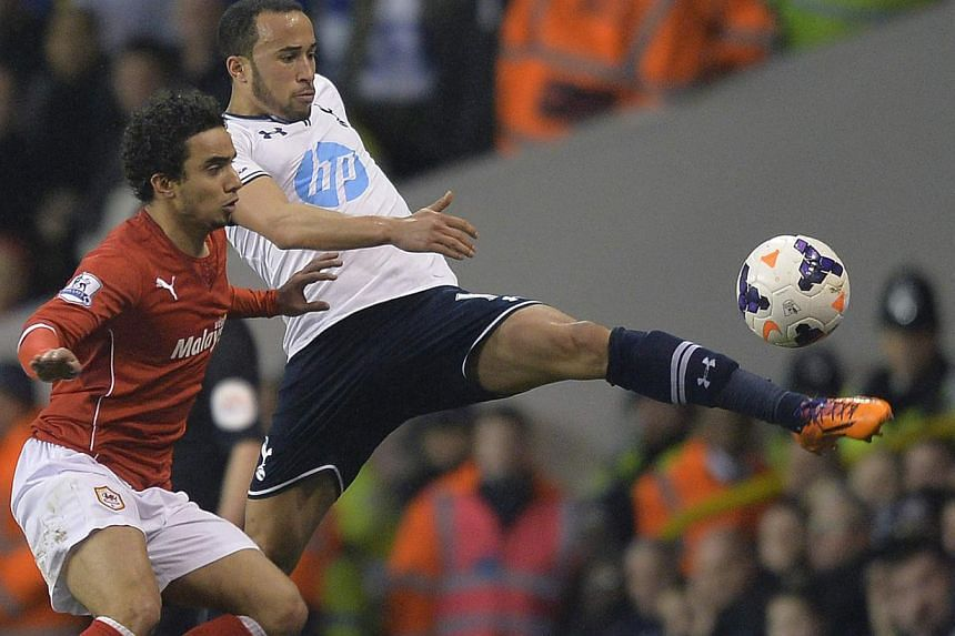 Cardiff City's Fabio da Silva (left) challenges for the ball with Tottenham Hotspur's Andros Townsend during their English Premier League soccer match at White Hart Lane in London, on March 2, 2014. Tottenham Hotspur announced on Wednesday that Andro