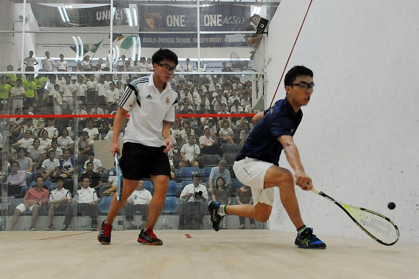 Anglo-Chinese School (Independent) defeated Raffles Institution (RI) 3-2 on Wednesday to claim their third consecutive Schools National Squash Championships title. -- ST PHOTO: MATTHIAS HO
