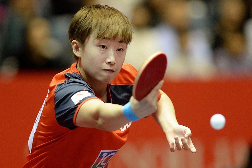 Feng Tianwei of Singapore returns a shot against Yang Ha Eun of South Korea at the World Team Table Tennis Championships in Tokyo on Wednesday, April 30, 2014. -- PHOTO: AFP