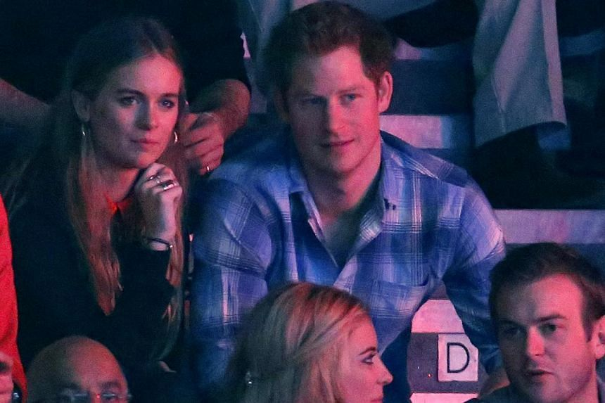 Britain's Prince Harry (right) and Cressida Bonas (second from right) watch the WE Day UK event at Wembley Arena in London on March 7, 2014. -- FILEPHOTO: REUTERS