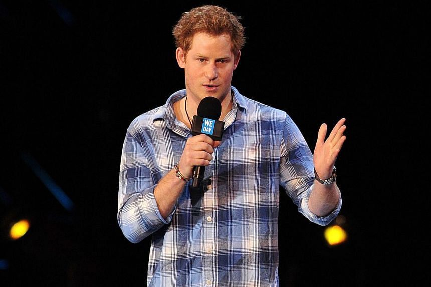 """Britain's Prince Harry speaks during the """"We Day"""" event in north west London on March 7, 2014. -- FILEPHOTO: AFP"""