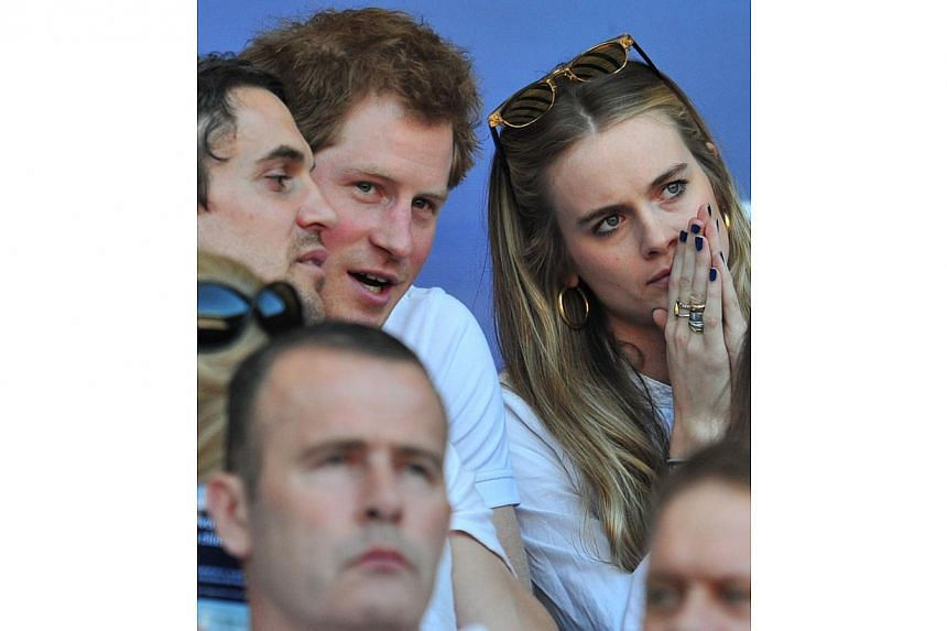 Britain's Prince Harry (second from left) and British socialite Cressida Bonas (right) watch the match during the Six Nations International rugby Union match between England and Wales at Twickenham, West London on March 9, 2014. -- FILEPHOTO: A