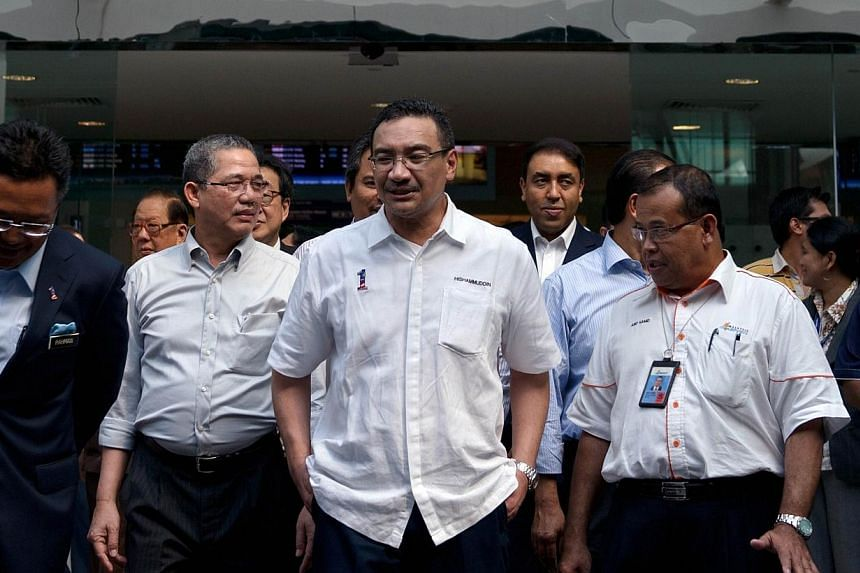Acting Transport Minister Hishammuddin Hussein (centre) visits the low-cost carrier terminal at Kuala Lumpur International Airport 2 in Sepang, outside Kuala Lumpur, on Wednesday, April 30, 2014. Malaysia will release on Thursday a preliminary report