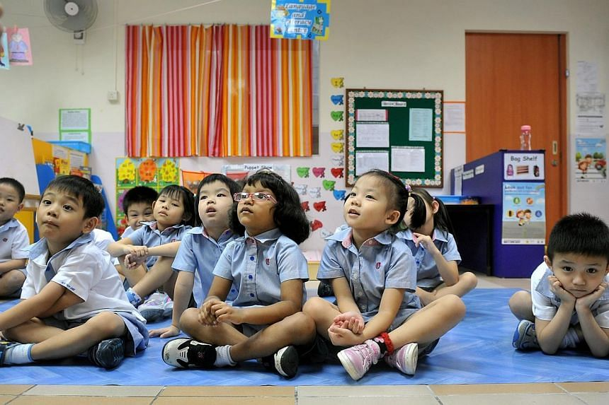 Pupils attend a Chinese reading lesson at the PAP Community Foundation Teck Ghee kindergarten on July 27, 2012. -- ST FILE PHOTO:KUA CHEE SIONG