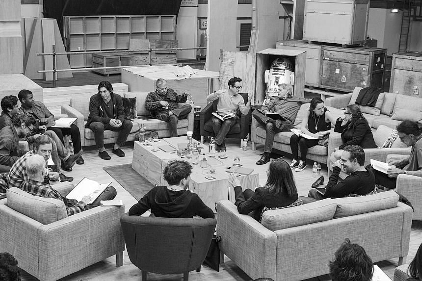 Writer/Director/Producer J.J. Abrams (top centre in glasses) conducts a cast reading for Star Wars: Episode VII at Pinewood Studios in Buckinghamshire in this publicity photo taken and released to Reuters April 29, 2014. Clockwise from Abrams are Har