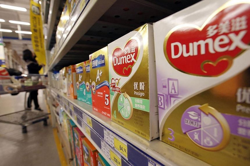 Dumex milk powder products of Danone are seen on display on shelves at a supermarket in Beijing, February 17, 2014.China will further tighten quality controls on milk imports by demanding that overseas suppliers register with the country's qual