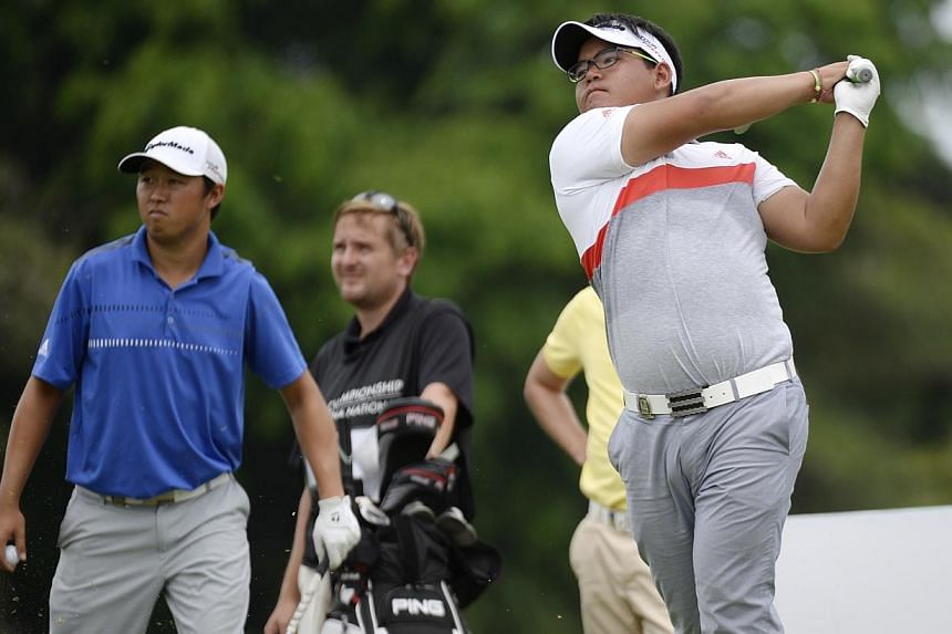 Panuphol Pittayarat teeing off at hole 17 at The Championship at Laguna National, while David Lipsky (Left) looks on.Thailand's Panuphol Pittayarat fired a sizzling nine-under-par 63 to lead after the opening round of The Championship at Laguna