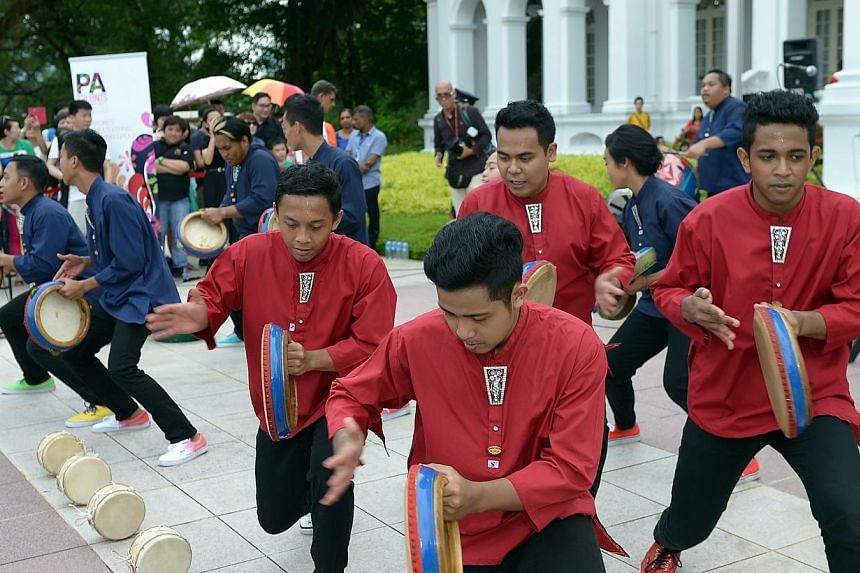 On Labour Day, the Istana opened its doors to about 15,000 members of the public, between 8.30am to 6pm.-- ST PHOTO: DESMOND WEE