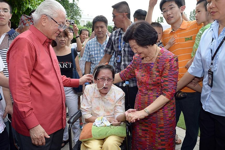 President Tony Tan Keng Yam and Mrs Mary Tan meet Madam Leow Jee Mua, 72 who was on a wheelchair at Istana Open House for Labour Day.On Labour Day, the Istana opened its doors to about 15,000 members of the public, between 8.30am to 6pm.-
