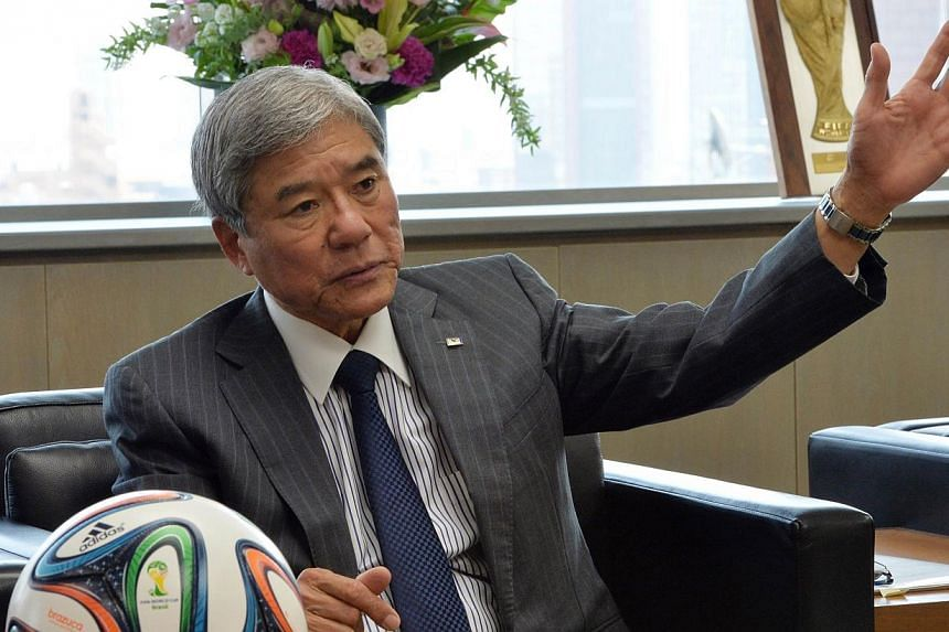 "This picture taken on March 28, 2014 shows Japan Football Association (JFA) president Daini Kuniya speaking during an interview with AFP at the JFA headquarters in Tokyo. Japan has apologised for ""creating a misunderstanding"" after suggesting it"