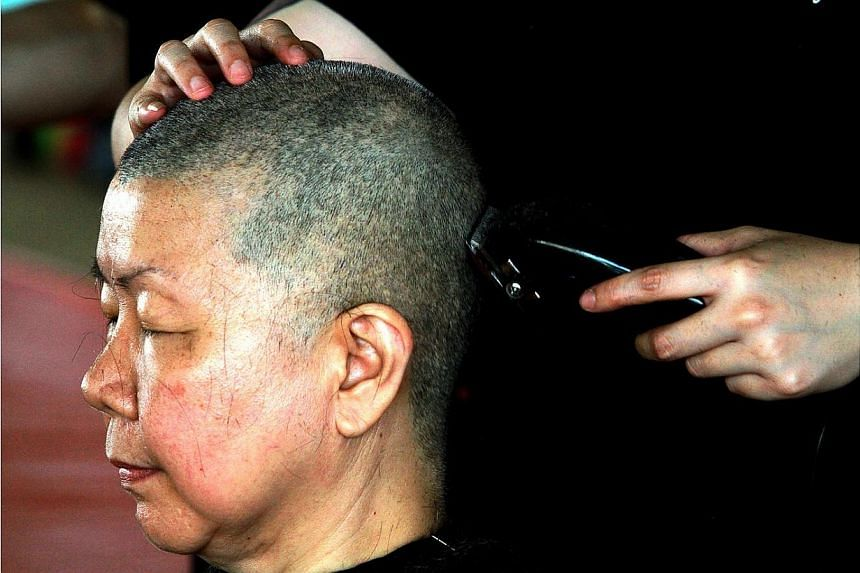 More than 240 people, including staff and Buddhist patrons of the Kong Meng San Phor Kark See Monastery, will be shaving their heads on Labour Day to kick off this year's Hair For Hope event. -- ST PHOTO:LAU FOOK KONG