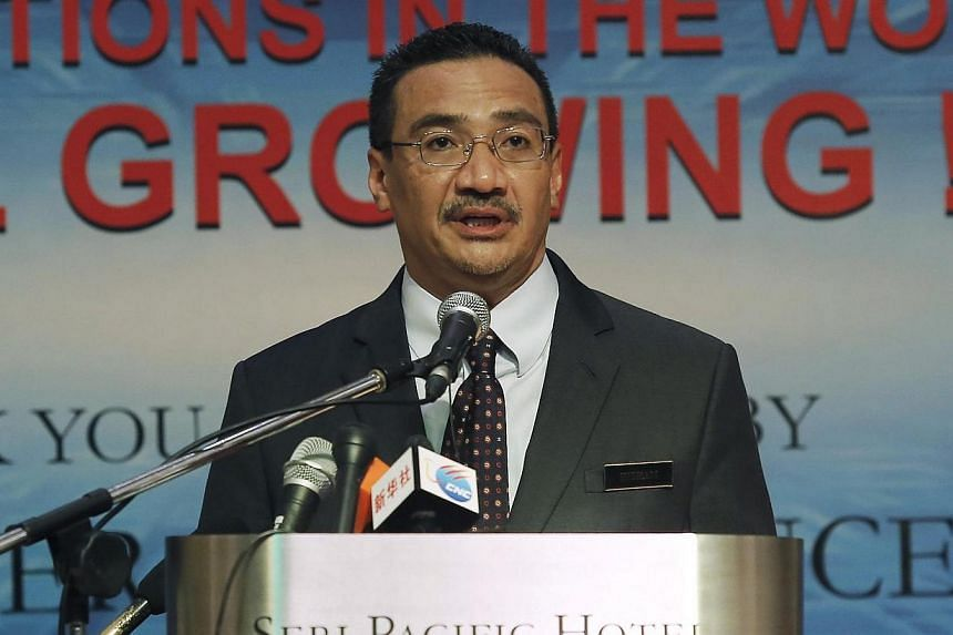 Malaysia's Defence Minister and acting Transport Minister Hishammuddin Hussein speaks at a news conference inside the hotel near the Putra World Trade Centre (PWTC) in Kuala Lumpur on April 17, 2014. Malaysia's Acting Minister for Transport Hish