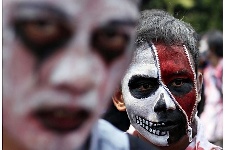 Indonesian Workers' Unions (KSPI) members take part in a May Day rally with their faces painted at the business district on May 1, 2014. -- PHOTO: REUTERS