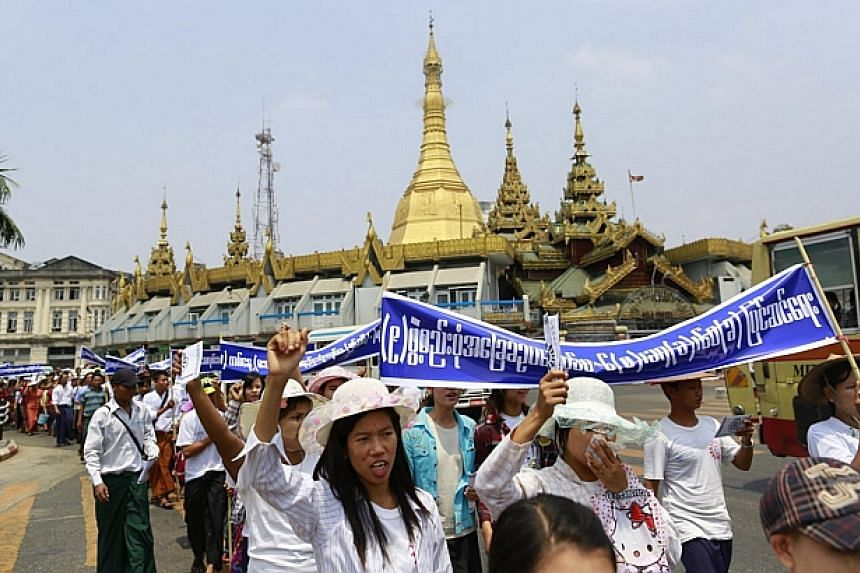 Members of the Myanmar Labour Union march during a May Day protest in central Yangon on May 1, 2014. -- PHOTO: REUTERS