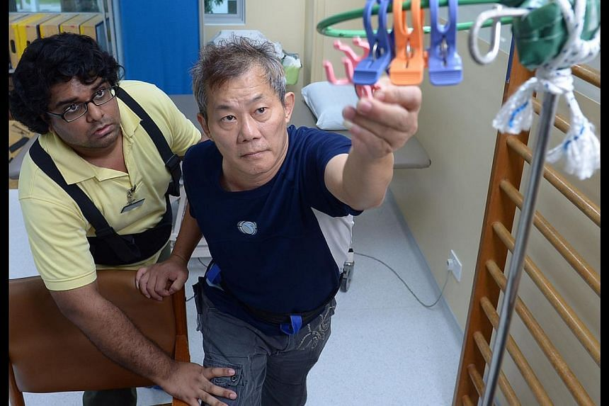 Mr Lim Peow Koon going through a rehabilitation exercise with therapy assistant Ian Richard Pereira at St Luke's Hospital in Bukit Batok yesterday. Mr Lim is among the minority of patients who faithfully return for rehab after their hospitalisation.
