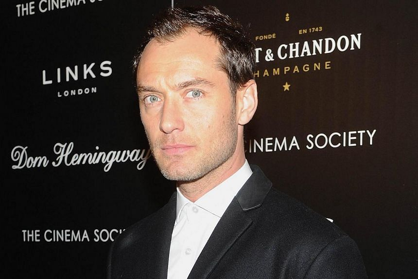 Actor Jude Law attends the Fox Searchlight Pictures' Dom Hemingway screening hosted by The Cinema Society And Links Of London on March 27, 2014 in New York City. -- FILE PHOTO: AFP