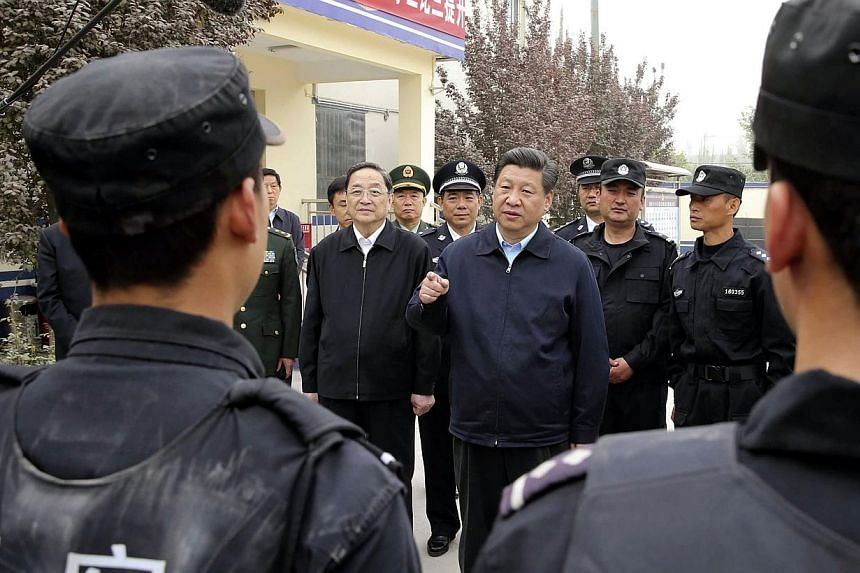 China's President Xi Jinping speaking at a police station in Kashgar, Xinjiang Uighur Autonomous region, on April 28, 2014, just days before the deadly attack on an Urumqi rail station. -- FILE PHOTO: REUTERS