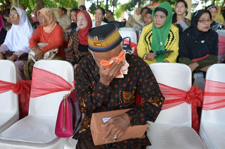 This picture taken in Makassar, Indonesia on Dec 11, 2013 shows an Indonesian veteran (front) attending a ceremony to commemorate victims of a notorious Dutch forces captain, Raymond Westerling, who masterminded the campaign on Sulawesi during the 19