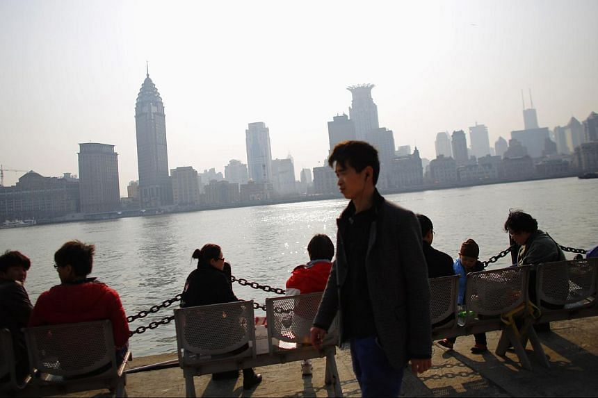 A man walking by the Huangpu River in downtown Shanghai, on March 14, 2014. -- FILE PHOTO: REUTERS
