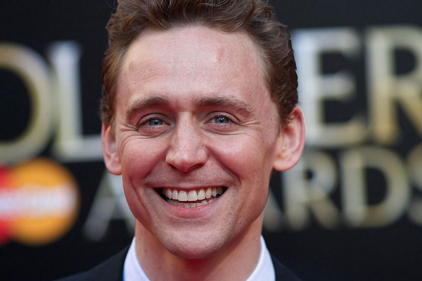 English actor Tom Hiddleston poses for pictures on the red carpet upon arrival to attend the Lawrence Olivier Awards for theatre at the Royal Opera House in central London on April 13, 2014. -- FILE PHOTO: AFP
