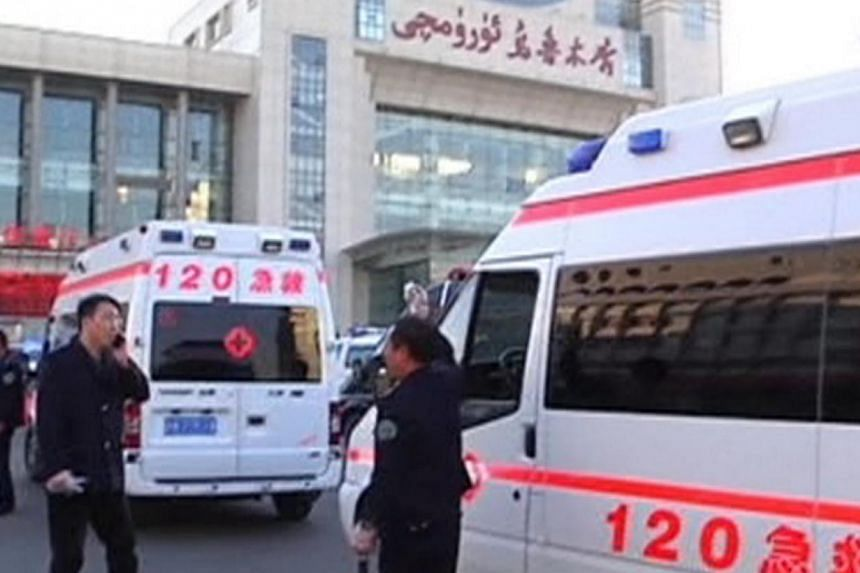Ambulances in front of the South Railway Station, where three people were killed and 79 wounded in a bomb and knife attack, in Urumqi in this still image taken from CCTV video shot on April 30, 2014. -- PHOTO: REUTERS