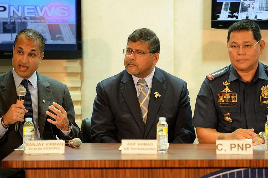 (From left) Interpol's Digital Crime Centre director Sanjay Virmani, Britain's Ambassador to the Philippines Asif Ahmad and Philippine police chief Alan Purisima during a press conference at the police headquarters in Manila on May 2, 2014.&nbsp