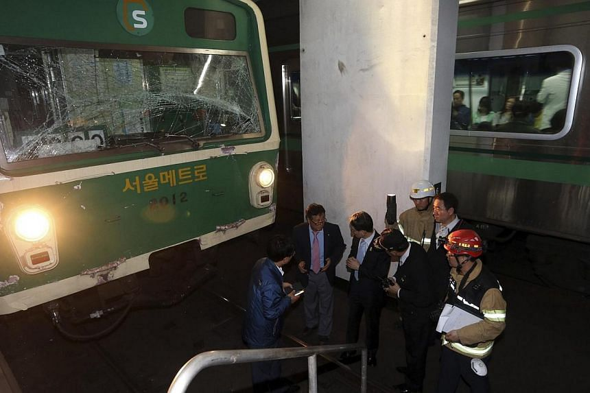 Two subway trains collided on Friday, May 2, 2014, at a station in the South Korean capital of Seoul, injuring 78 passengers,the emergency services said, although none appeared to be seriously hurt.-- PHOTO: REUTERS