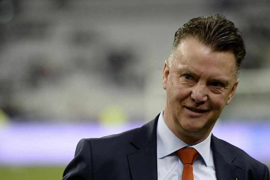Netherlands' coach Louis van Gaal waits for the start of a friendly football match between France and Netherlands at the Stade de France in Saint-Denis near Paris on March 5, 2014, ahead of the 2014 FIFA World Cup football tournament.Louis van