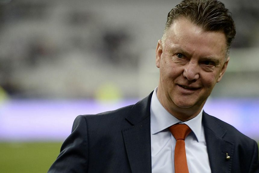 Netherlands' coach Louis van Gaal waits for the start of a friendly football match between France and Netherlands at the Stade de France in Saint-Denis near Paris on March 5, 2014 ahead of the 2014 FIFA World Cup football tournament. -- FILE PHOTO: A