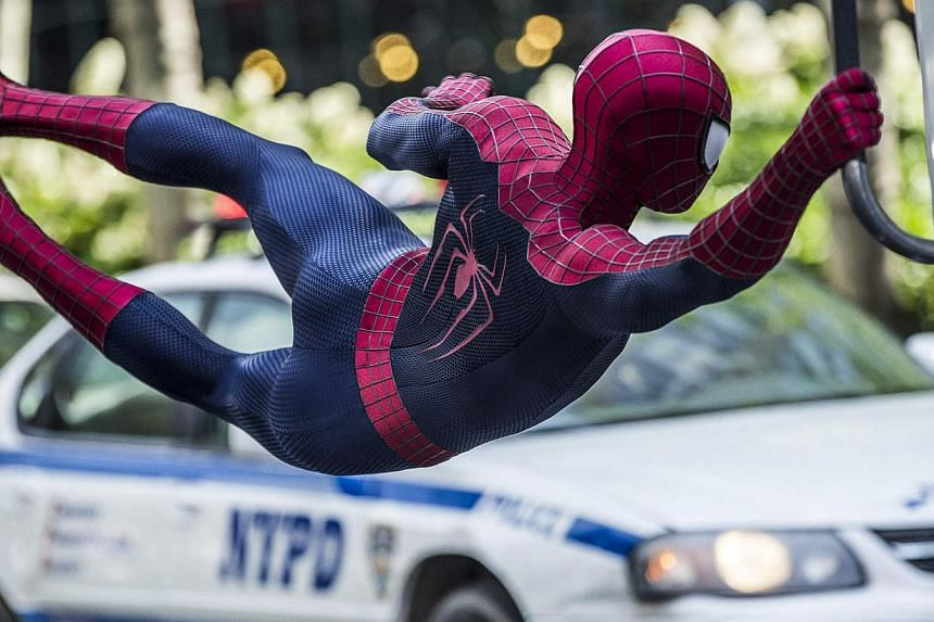 Andrew Garfield dons the costume a second time (above) in The Amazing Spider-Man 2. He and actress Emma Stone, who plays his girlfriend, share wonderful chemistry. -- PHOTO: SONY PICTURES