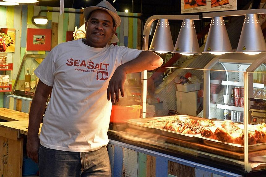 Huber's director Andre Huber says its deli at PasarBella stood to lose more money staying open than closed, but Sea Salt owner Ivan Agramonte (above) sees potential in his business there. -- PHOTO: DESMOND FOO