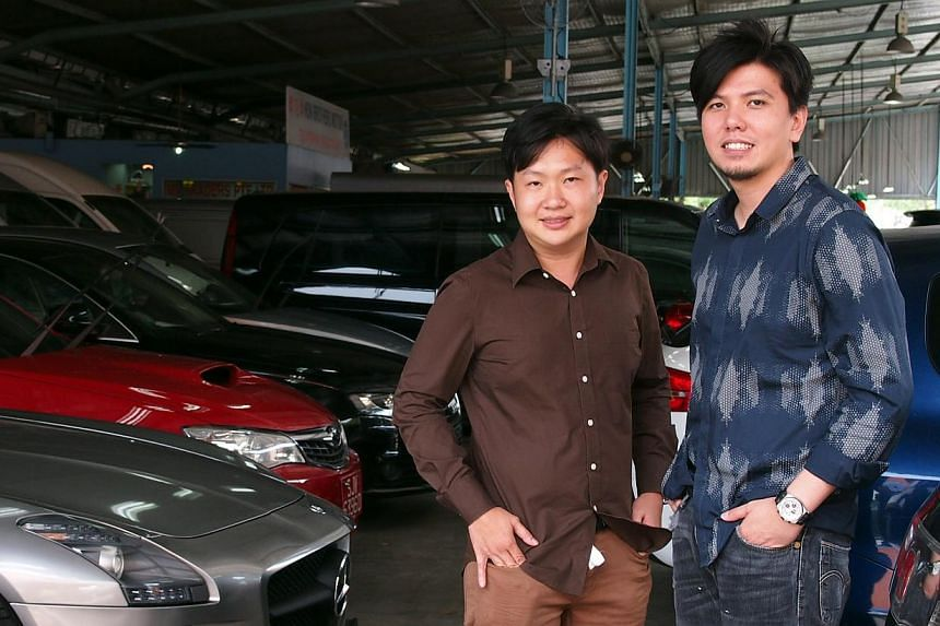 Used-car dealers Mr Fed Wu (left) and Mr Bret Chia have both had customers who complained about worn-out parts. Mr Wu said that in some cases, the cars were damaged by the buyer's mechanic.