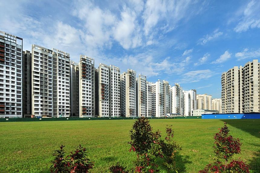 HDB resale transactions fell to just 18,100 last year, the fewest since 1997. Resale prices also fell 0.6 per cent over 2013. -- ST PHOTO: ALPHONSUS CHERN