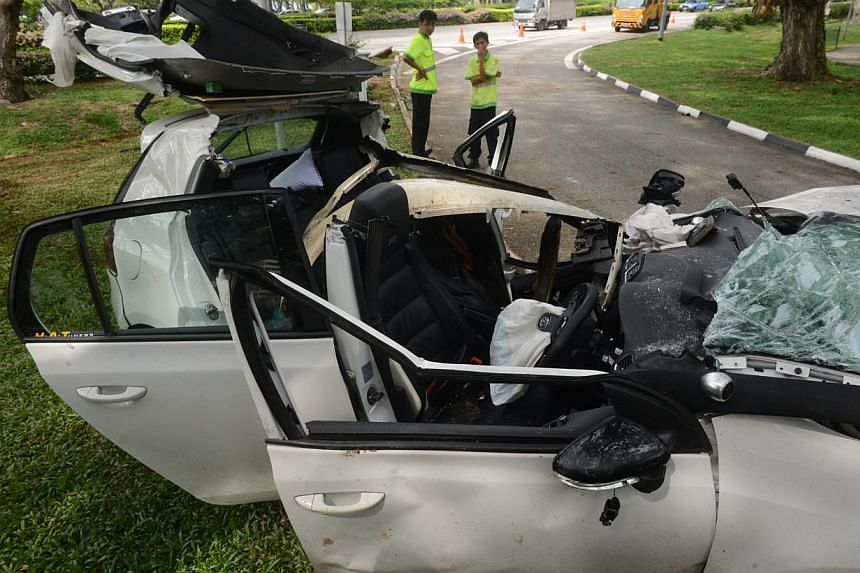 The mangled remains of the white Volkswagen that crashed on East Coast Parkway yesterday.