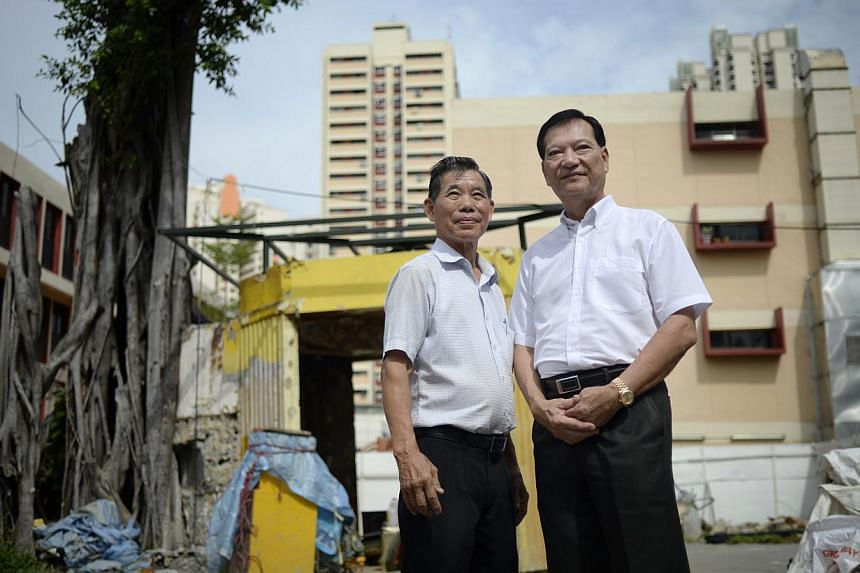 Toa Payoh Central Merchants' Association vice-chairmen Lim Her Chang and Lim Kok Siong are among business owners who have stepped up to restore the shrine, which pre-dates the HDB estate. -- ST PHOTO: DESMOND LIM